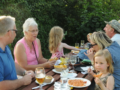 A family enjoying a meal in a local pub beer garden